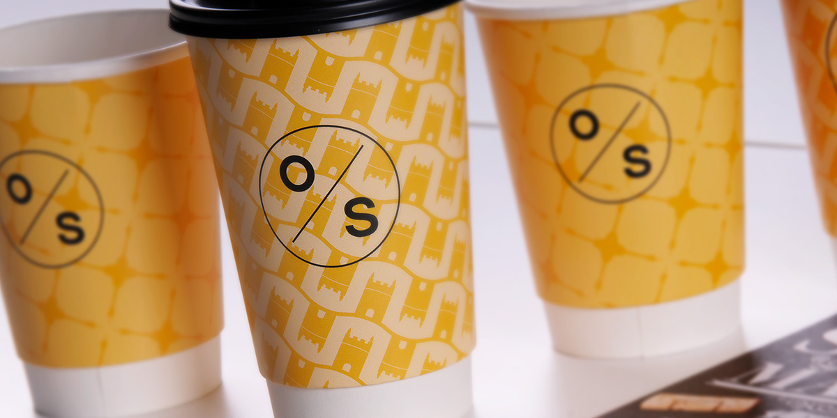 Coffee cup packaging design for The Old Stocks Inn by Mighty, hotel marketing agency
